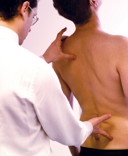 male-osteopath-with-female-patient.jpg